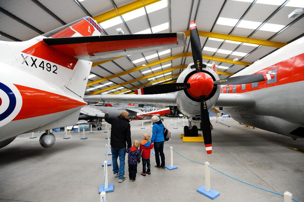 Grandparents and Grandchildren looking at the planes at Newark Air Museum