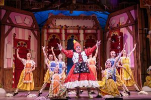 Pantomime cast on stage at Palace Theatre Newark