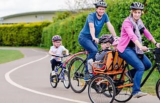 A family with young children on a bike ride