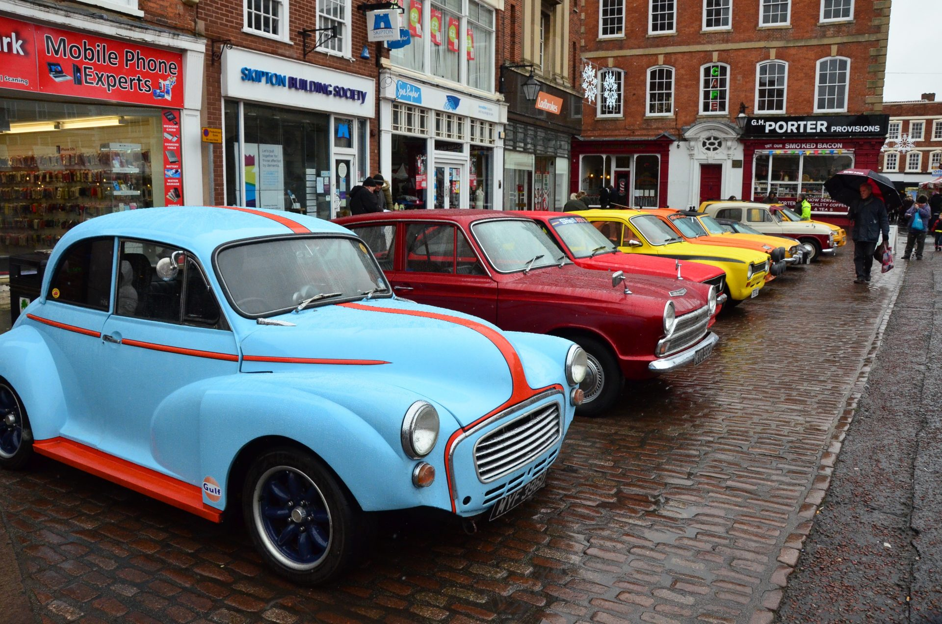 A row of vintage cars lined up in Newark Market
