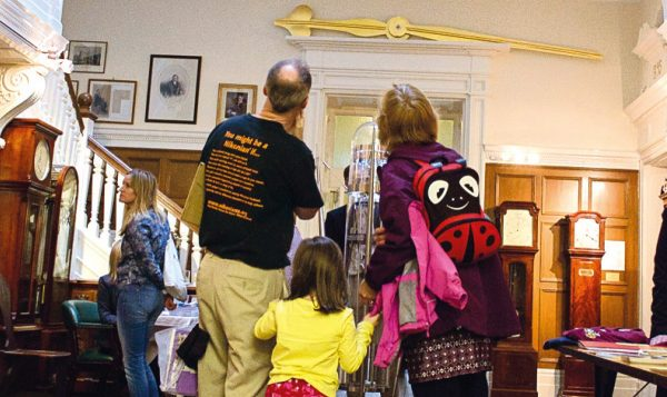 Family looking at an exhibition at the Museum of Timekeeping