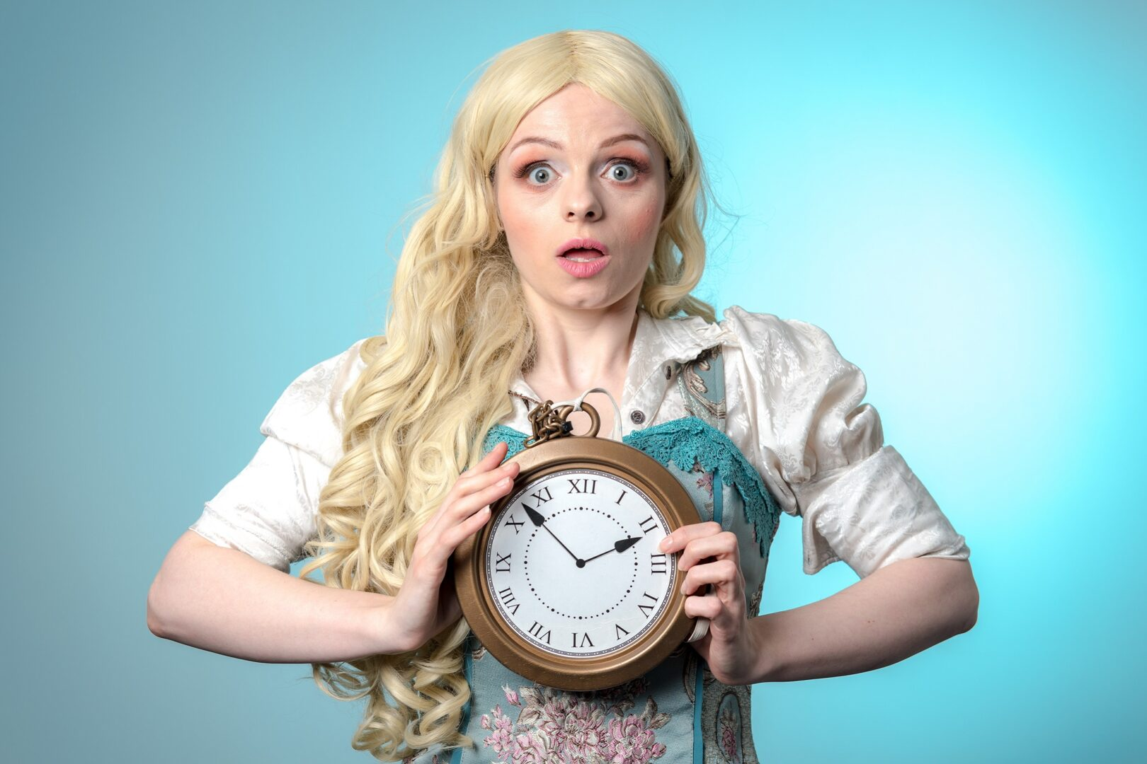 The title character of Alice in Wonderland, Alice, clutches a clock with a shocked expression